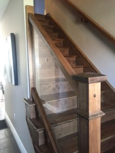 birch hardwood stairs and railings along with glass panel